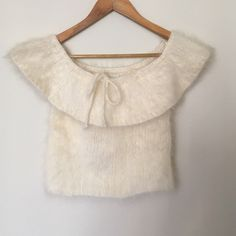 100% Angora Perry Ellis hand knitted top 100% Angora Perry Ellis hand knitted top in cream. Super soft and adorable. In good condition. Can be a crop top or layered with a shirt. Tops