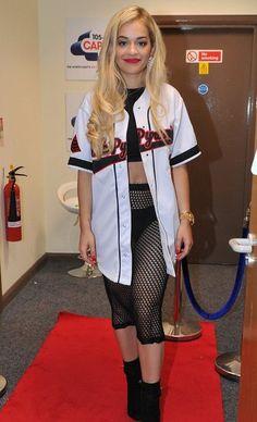 Rita Ora Rihanna for River Island fishnet skirt. Baseball jersey. Black crop top. Black booties, pumps. Tomboy glam.   Sunderland June 22 2013