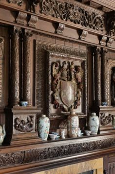 The carved wooden coat of arms above the chimneypiece in the Tapestry Room, The Vyne, Hampshire.