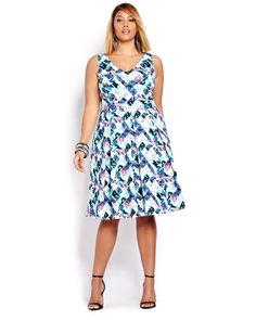 Here is a sophisticated short dress for a cocktail party. Printed plus size dress with built-in crinoline, V neckline and zipper. 39 inch length. Try a little something retro!