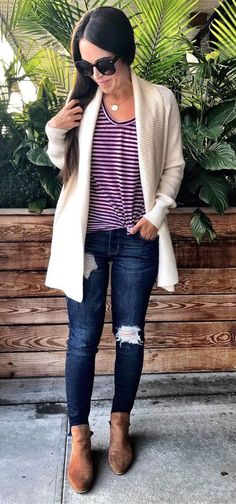 how to wear a stripped top : white cardigan + rips + boots