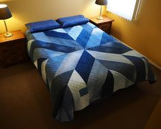 Giant blue quilt sewn with upcycled jean fabric. Made by Craftsy member Stitch and Yam