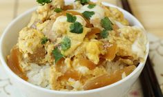 Oyakodon is chicken and egg in seasoned broth over rice in a bowl.