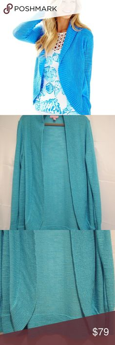 """Lilly Pulitzer L Pool House Blue Amalie Cardigan Lilly Pulitzer Amalie Cardigan.  L   Pool house blue.   Shows as new.   Viscose polyester blend, machine wash.  Long sleeve.  Slub look   Chest 44"""", length 29"""", under arm to end of sleeve 19"""". Lilly Pulitzer Sweaters Cardigans"""