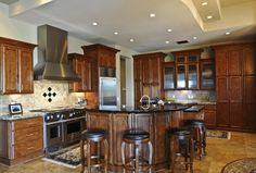 Contemporary Kitchen with Wolf PWC482418, Breakfast bar, Stone Tile, limestone tile floors, Limestone Tile, Slate counters