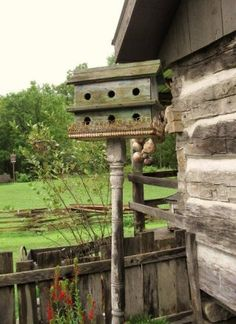 Rustic Garden Birdhouse...on an old porch spindle.