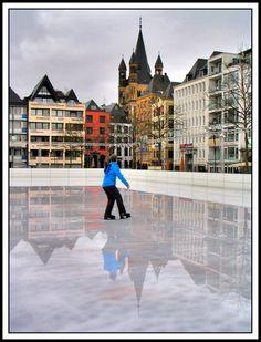 Winter fun in an ice rink on Neumarkt in de old town of Cologne, Nordrhein-Westfalen_ West Germany