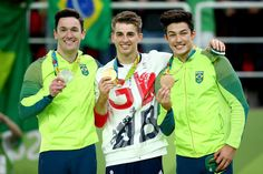 (L to R) Silver medalist Diego Hypolito of Brazil, gold medalist Max Whitlock of Great Britain, bronze medalist Arthur Mariano of Brazil pose on the podium at the medal ceremony for Men's Floor Exercise on Day 9 of the Rio 2016 Olympic Games at the Rio Olympic Arena on August 14, 2016 in Rio de Janeiro, Brazil.
