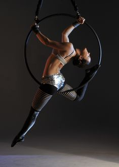 A bit nostalgic tonight. Really miss doing aerial hoop! (This is another gorgeous lady - not me)