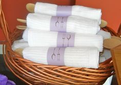 Shower Favors: Wooden cooking spoon wrapped in a simple kitchen towel from Target with stamped paper ring