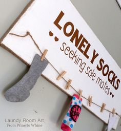Lonely Socks Art Board, 20 Laundry Room Organization Ideas via A Blissful Nest