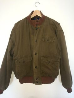 This is a rare vintage Polo by Ralph Lauren wool lined khaki bomber jacket. Made in a lovely caramel colored khaki cotton, with warm brown ribbed