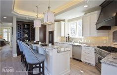 """Emmett Lakefront living is not often luxurious and conscious of size. The """"Emmett"""" design achieves both of these goals in … Kitchen Interior, House, Home, Lakefront Homes, Floor Plan Design, New Homes, Craftsman Style House Plans, Home Builders, Dream Rooms"""
