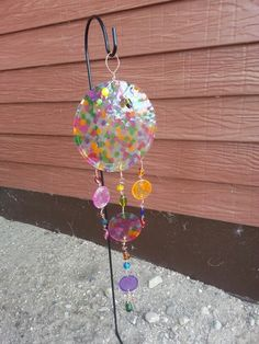 Melted pony beads, wire, and glass bead accents...diy garden art sun catcher!!