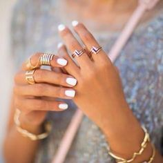 A simple white manicure tends to make jewelry pop. | 16 Things You Never Realized You Could Do With White Nail Polish