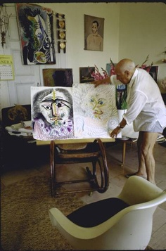 One of series of thirteen views of animated Pablo Picasso arranging displays of his paintings at his home in Notre-Dame-de-Vie, Mougins.  Location:	Mougins, France  Date taken:	July 1967  Photographer:	Gjon Mili