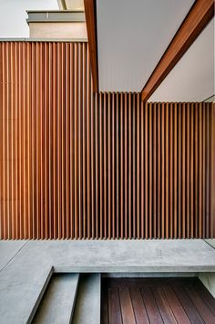 Appealing Exterior Details With Wooden Shutters, The Concrete Floor, The White Ceiling And The Hardwood Floor