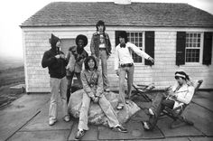 The Rolling Stones, with guest percussionist Ollie E. Brown, outside their rehearsal room at Andy Warhol's Montauk Church Estate 1975