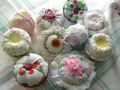 Pin cushions made from old tin jello molds spray painted in pastels.