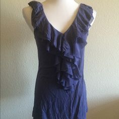Express Purple Shadow Ruffle Front Top This top is beautiful! The color is gorgeous and it's super comfortable. Jersey stretch with ruffles on the front. General wear with no imperfections. Very good condition. Express Tops Tank Tops