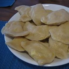 Dough rounds filled with potato, bacon, cheese and sauerkraut filling mixtures, then dropped in boiling water for 5 minutes.