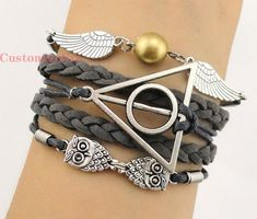harry potter bracelet - I want! $5.66 on etsy  Even if it weren't HP, I'd still find it totally adorable!
