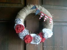 Americana Door Wreath -- Celebrate the Flag! ~ * THE COUNTRY CHIC COTTAGE (DIY, Home Decor, Crafts, Farmhouse)... I would wrap wreath form in denim- different washes (colors) even -use worn out jeans with holes even,  I would make banner a little bigger.  Love the design and could do for any color theme or any holiday!