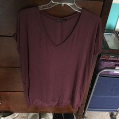v-neck oversized, loose fit, one seize fits all, maroon, good condition Brandy Melville Tops Tees - Short Sleeve