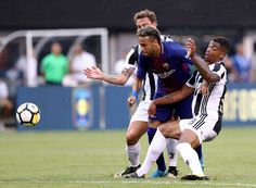 Mario Lemina #18 and Stefano Sturaro #27 of Juventus stop Neymar #11 of Barcelona as he tries to score in the first half during the International Champions Cup 2017  on July 22, 2017 at MetLife Stadium in East Rutherford, New Jersey.