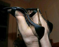 This is the way I like fukkin Layla through a hole in her sweaty feet reinforced toe & heel black pantyhose with her funky feet on my shoulders