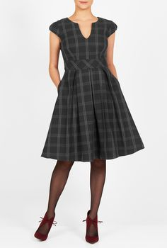A split neck accentuates the bodice of our heavier weight twill check fit-and-flare dress fashioned with a flattering fitted inset waist above a box-pleat skirt.