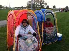 "Called ""Under the Weather""... a portable ""tent"" that pops up and fits over your chair!  Perfect for the ball field! http://under-the-weather.com/index.php"