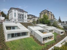 urban villas on lake lucerne create hillside periscopes