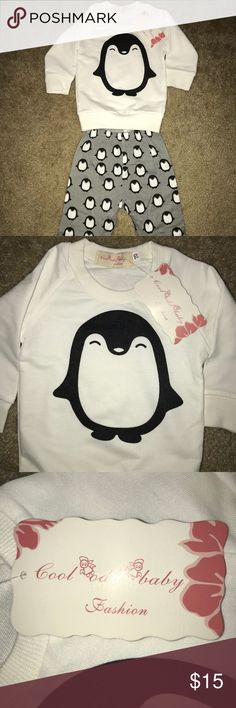 NWT Unisex Penguin Outfit, Size 6 Months! Cute! Brand new white sweatshirt with cute penguin on front with matching gray pants covered with penguins. For baby boy or girl! If you have any questions please contact me and thanks for looking! I love offers and bundles! Thanks again! Cool Odd Baby Fashion Matching Sets