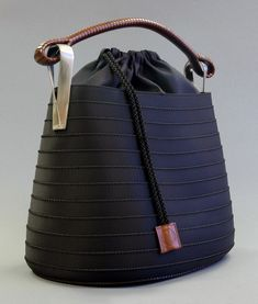 Great black faille and brown leather bag by Kenzo of Japan, ca. 1998.
