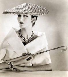 """Carmen Dell Orefice, 1956, wearing a hat called """"Country Weekend""""."""