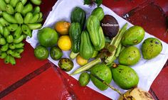 Organic zabouca, ochro, christophene, pommecythere, bananas, coconut water, dry coconut and limes (all from Brasso Seco, Trinidad)