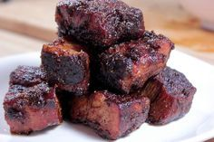 Complete instructions and step by step pictures for pork burnt ends. They are to die for and injecting them with spicy butter puts them over the top in flavor.