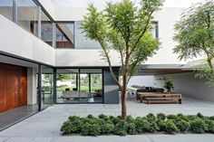 A central courtyard between wings of the house offers natural ventilation when paired with the large, sliding windows that dominate the design. By keeping the courtyard nestled between different pieces of the home, residents are allowed to enjoy the outdoors with friends and family without exposing themselves to prying eyes.