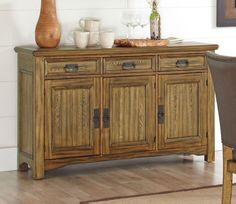 This rustic Salerno Server by Coaster Furniture will be a great addition to your dining room. With three drawers and three doors, there is plenty of room to keep your fine dinnerware organized and out of sight and mind when not in use. The server is simpl Dining Room Server, Buffet Server, Coaster Fine Furniture, Dining Room Furniture, Sideboard, Coasters, Table Settings, Aiko, Rustic