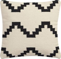 zig to the zag.  Cotton yarn weaves a graphic interpretation of a traditional kilim pattern.  Bold design with neutral palette perfectly layers with almost any decor.  Reverses to 100% cotton in solid ivory.  Do the math: CB2 low prices include a pillow insert in your choice of plush feather or lofty down alternative (a rare thing indeed).