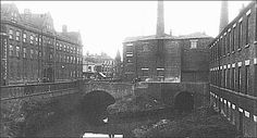 The tunnels were the canal enters Stoke town..  This location shows where the canal goes into two tunnels - one into the Wolfe Street pottery works and one under Stoke town centre and onto the Trent and Mersey canal.  Above the tunnels is a flint mill - to the left are the imposing industrial buildings of Minton, with a long three-storyed building, rising to four storeys in the centre.. Old Pottery, Stoke On Trent, Local History, Old Photos, Good Times, Industrial, Street View, Shows, Centre