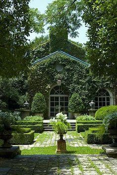 Love this lush, overgrown garden look.