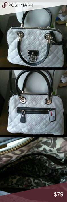 GUESS ALIZA LUXE DOME SATCHEL QUILTED BAG GUESS ALIZA LUXE DOME SATCHEL QUILTED OFF-WHITE PURSE  BEAUTIFUL Everything about this purse is excellent. Has a removable shoulder strap and hand straps (in black) and the quilted bag itself is in off-white. Inside lining is leopard with the Guess logo throughout. Inside has a zippered pocket on one side and several pockets on the other. Zips closed. Faux leather.  Imported Guess Bags Satchels