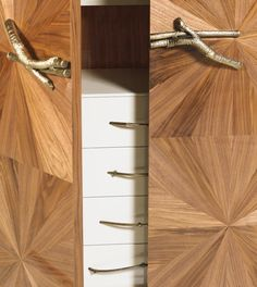 Walnut Cabinet | Desiner Pedro Sousa for the brand Ginger & Jagger | The symmetric graphical wood work comes to our thoughts as a ray of light passing in the trees. The detailed branched metal handle deceives us, they make us think it is impossible to open the doors.
