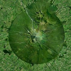 """""""Mount Taranaki, also known as Mount Egmont, is an active stratavolcano on the west coast of New Zealand's North Island. A change in vegetation is sharply…"""" Port Of Singapore, Star Fort, World Images, Shades Of Green, West Coast, Cool Photos, Amazing Photos, New Zealand, Perspective"""