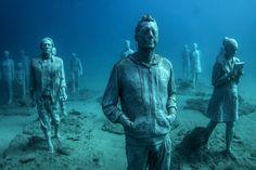 Hyperrealistic Human Sculptures Submerge Underwater Art Museum in Europe