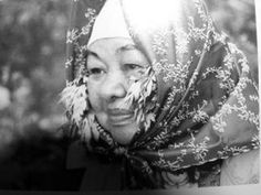An Ainu woman with mugwort leaves in her scarf - While walking/working in the places where devils were thought to be present, Ainu people used to put branches of mugwort on their head, usually along two ears wrapping by a scarf, and facing the upside of the branches forward. This links to an article regarding more about the Ainu uses and beliefs regarding mugwort.