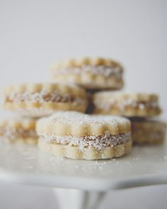Alfajores- shortbread cookies sandwiching dulce de leche then rolled in coconut