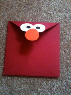♥♥ ✉ Elmo Envelopes. It is so simple to make an envelope of a recognizable color and add cartoon eyes and nose to get a character. Why didn't I think of this? ✉